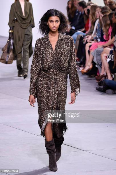 Imaan Hammam walks the runway at the Michael Kors Collection Fall 2017 show at Spring Studios on at Spring Studios on February 15 2017 in New York...