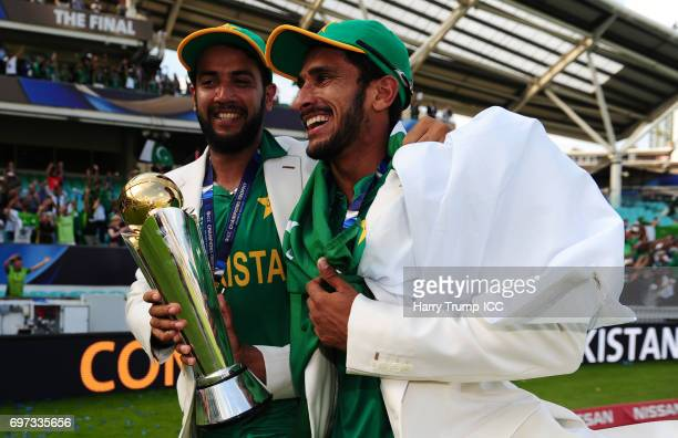 Imad Wasim and Hassan Ali of Pakistan celebrate with the trophy during the ICC Champions Trophy Final match between India and Pakistan at The Kia...