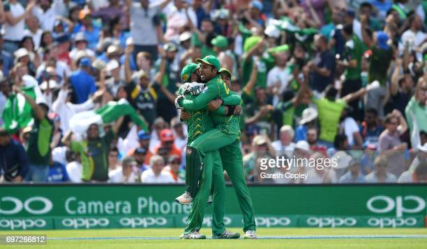 Imad Wasim of Pakistan celebrates with captain Sarfraz Ahmed after catching out MS Dhoni of India during the ICC Champions Trophy Final between India...