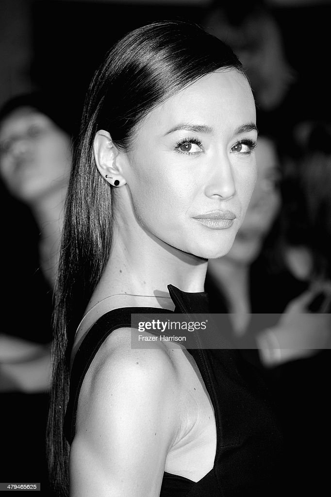 Image Converted to Black and White from Colour). Actress <a gi-track='captionPersonalityLinkClicked' href=/galleries/search?phrase=Maggie+Q&family=editorial&specificpeople=555127 ng-click='$event.stopPropagation()'>Maggie Q</a> arrives at the premiere Of Summit Entertainment's 'Divergent' at Regency Bruin Theatre on March 18, 2014 in Los Angeles, California.