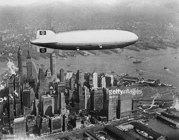 Image dated of the 30's showing German giant airship Hindenburg flying over Manhattan island in New York