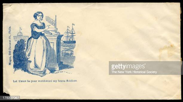 Image depicts a woman pointing to the word 'Union' as she looks toward a ship at sea