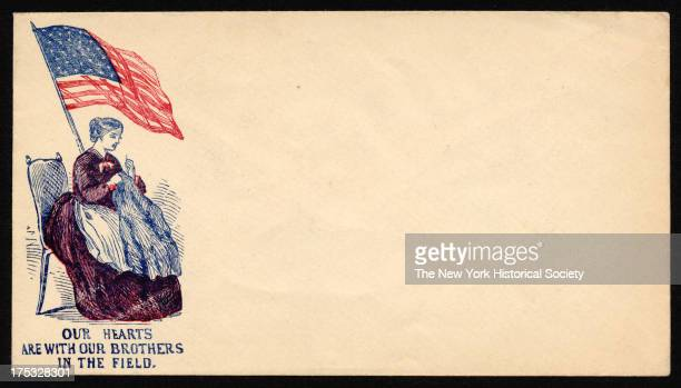 Image depicts a woman sitting by American flag sewing