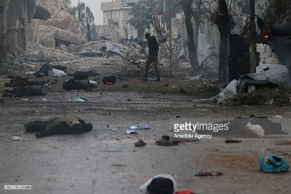 Image depicts death] Dead bodies lay on the ground at the impact site after war crafts belonging to the Assad Regime forces carried out airstrikes...