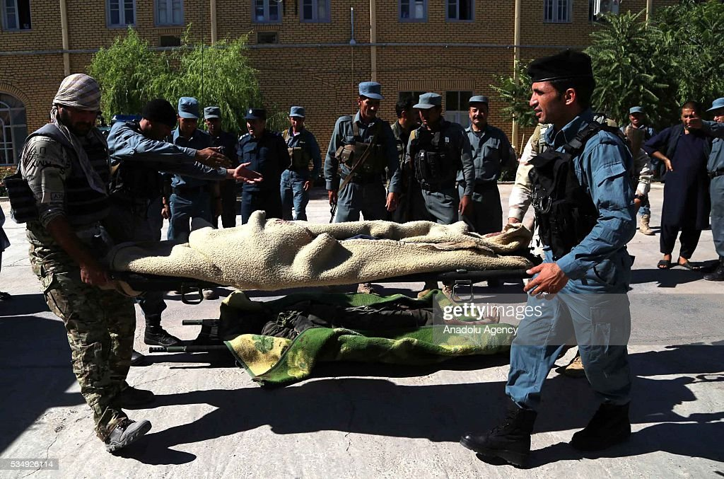 Image depicts death] Security forces take security measures as they carry dead bodies following clashes with Taliban militants in Guzara District of Herat, Afghanistan on May 28, 2016. At least 5 killed during the clashes.