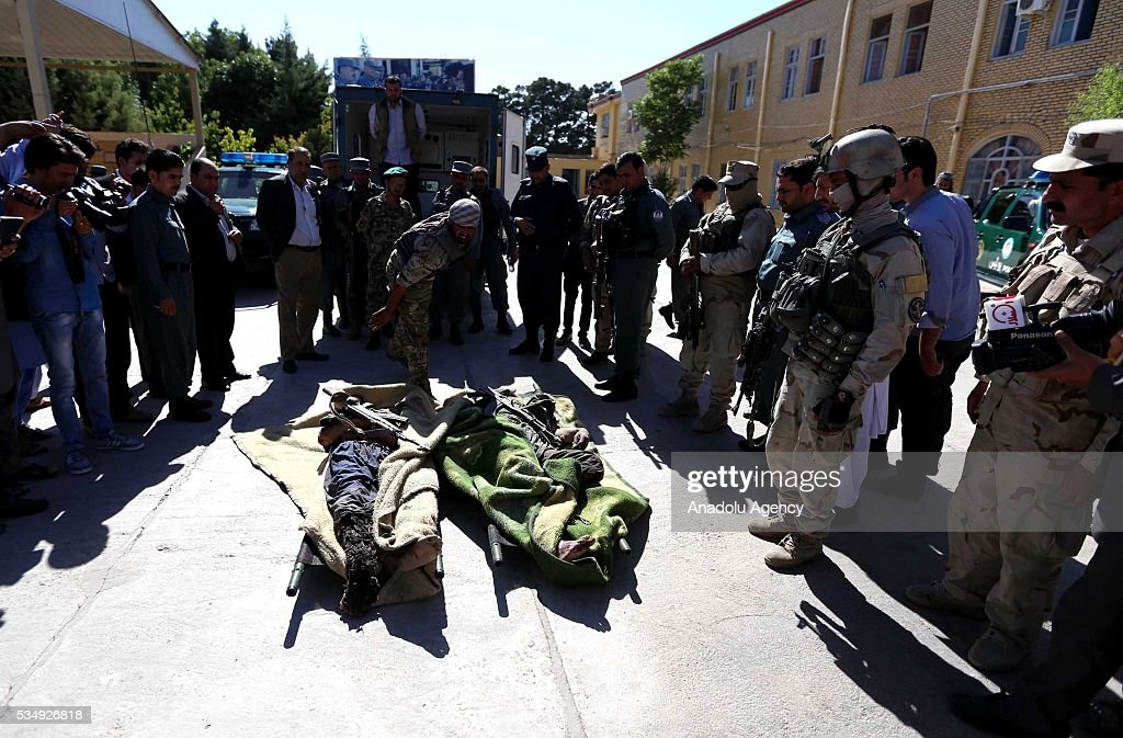 Image depicts death] Security forces take security measures as they wait near dead bodies following clashes with Taliban militants in Guzara District of Herat, Afghanistan on May 28, 2016. At least 5 killed during the clashes.