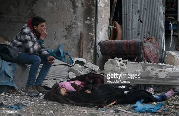 Image depicts death] Syrian man cries near a dead body of a girl after war crafts belonging to the Assad Regime forces carried out airstrikes over...