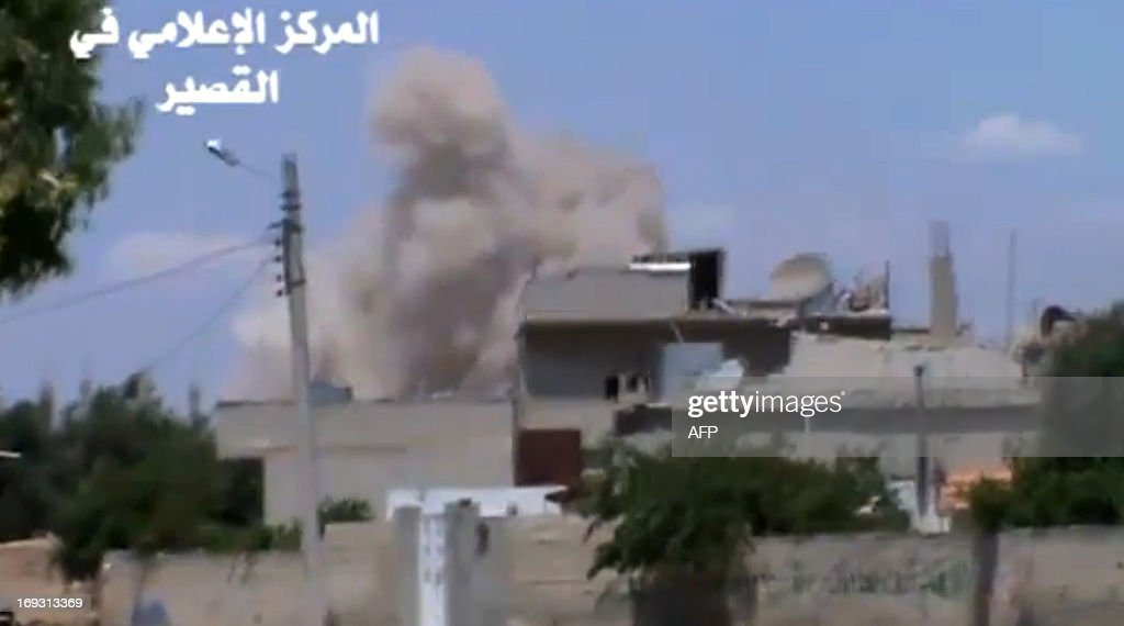 A image grab taken from a video uploaded on Youtube by Al-Qusayr Media Centre on May 22, 2013 allegedly shows smoke billowing from buildings in the city of Qusayr, in Syria's central Homs province, following an airstrike by government forces. Syrian rebels are facing a massive onslaught by the army and elite Lebanese Shiite Hezbollah troops in the central city, as Syria's main opposition group gathers for a landmark conference in Istanbul, Turkey, to discuss peace talks with the regime. AFP PHOTO / HO /AL-QUSAYR MEDIA CENTRE CREDIT 'AFP PHOTO / AL-QUSAYR MEDIA CENTRE' - NO