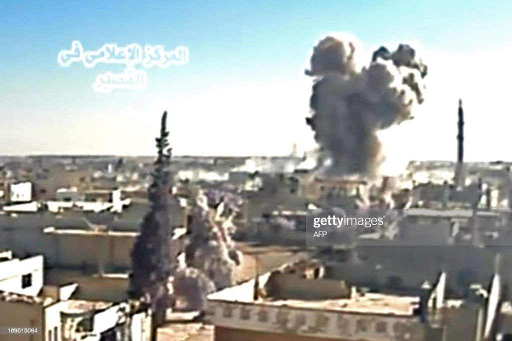 A image grab taken from a video uploaded on Youtube by Al-Qusayr Media Centre on May 26, 2013 allegedly shows smoke billowing from buildings in the city of Qusayr, in Syria's central Homs province, following an airstrike by government forces. Forces loyal to Syria's President Bashar al-Assad supported by Hezbollah fighters launched an assault on Qusayr a week ago but are still being fiercely resisted by rebels. AFP PHOTO / HO /AL-QUSAYR MEDIA CENTRE CREDIT 'AFP PHOTO / AL-QUSAYR MEDIA CENTRE' - NO