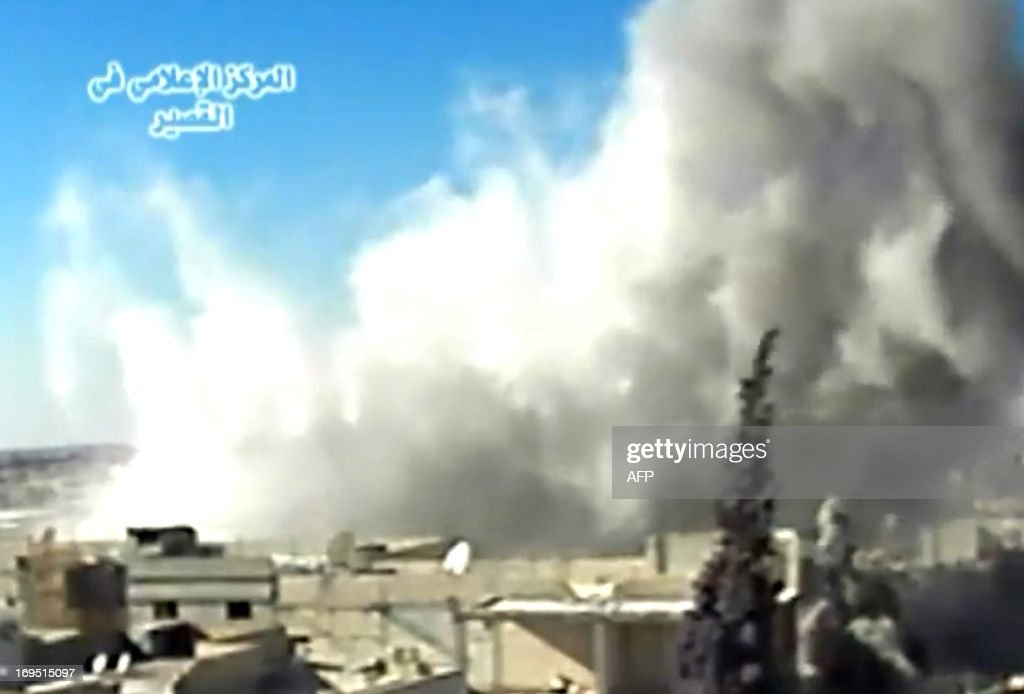 A image grab taken from a video uploaded on Youtube by Al-Qusayr Media Centre on May 26, 2013 allegedly shows smoke billowing from buildings in the city of Qusayr, in Syria's central Homs province, following an airstrike by government forces. Forces loyal to Syria's President Bashar al-Assad supported by Hezbollah fighters launched an assault on Qusayr a week ago but are still being fiercely resisted by rebels. AFP PHOTO / HO /AL-QUSAYR MEDIA CENTRE CLIENTS ==