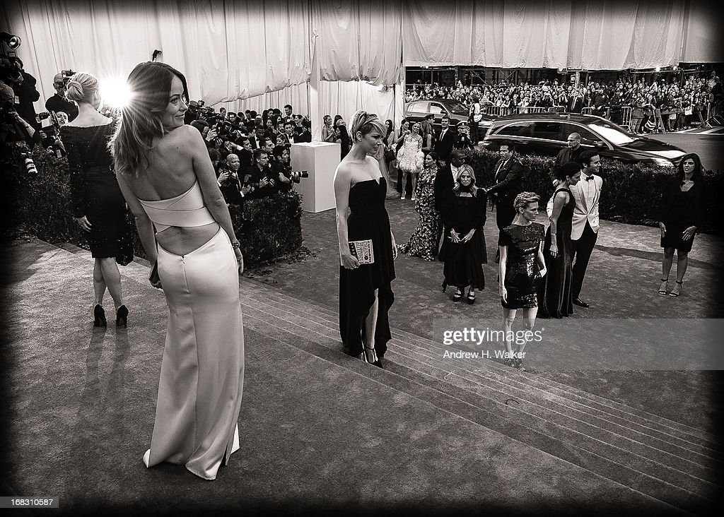 image has been digitally processed and converted to black and white] Olivia Wilde (L) and Michelle Williams (C) attend the Costume Institute Gala for the 'PUNK: Chaos to Couture' exhibition at the Metropolitan Museum of Art on May 6, 2013 in New York City.