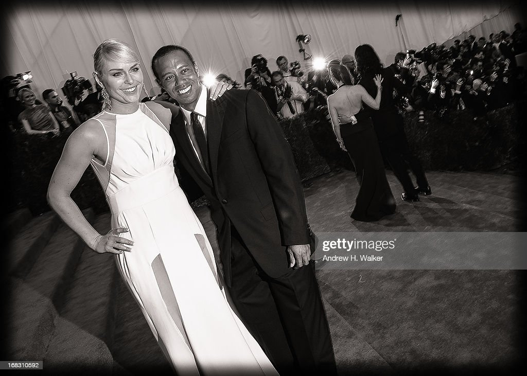 image has been digitally processed and converted to black and white] Lindsey Vonn and Tiger Woods attend the Costume Institute Gala for the 'PUNK: Chaos to Couture' exhibition at the Metropolitan Museum of Art on May 6, 2013 in New York City.
