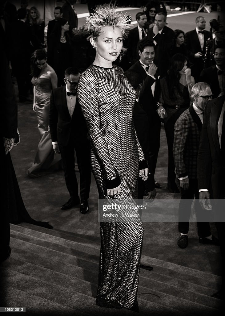 image has been digitally processed and converted to black and white] Miley Cyrus attends the Costume Institute Gala for the 'PUNK: Chaos to Couture' exhibition at the Metropolitan Museum of Art on May 6, 2013 in New York City.