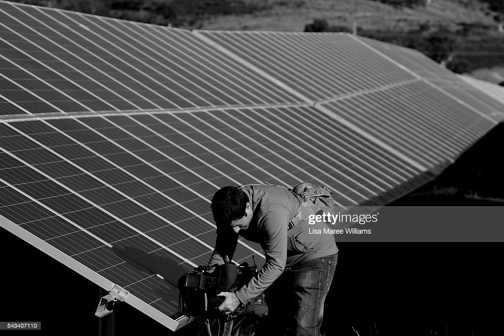 Image has been shot in black and white, no colour version available.) A camera person shoots at the Royalla Solar Farm during a tour by Leader of the Opposition, Australian Labor Party Bill Shorten on June 28, 2016 in Canberra, Australia. Bill Shorten used the visit to outline Labor's policy plans for the renewable energy sector, address climate change and the creation of jobs.