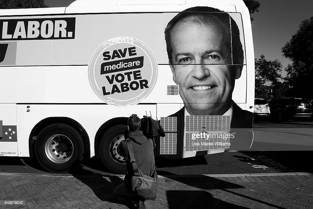 Image has been shot in black and white, no colour version available.) A camera person films the Leader of the Opposition, Australian Labor Party Bill Shorten's campaign bus during a visit to Riverwood Community Centre in Canterbury on June 29, 2016 in Sydney, Australia. Bill Shorten is campaigning heavily on Medicare, promising to make sure it isn't privatised if the Labor Party wins the Federal Election on July 2.
