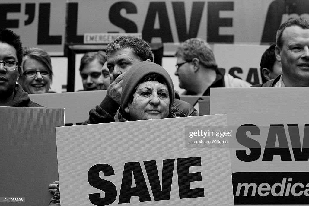 Image has been shot in black and white, no colour version available.) Labor Party supporters hold signs during a Medicare Rally at Martin Place on July 1, 2016 in Sydney, Australia.Bill Shorten is campaigning heavily on Medicare, promising to make sure it isn't privatised if the Labor Party wins the Federal Election on July 2.