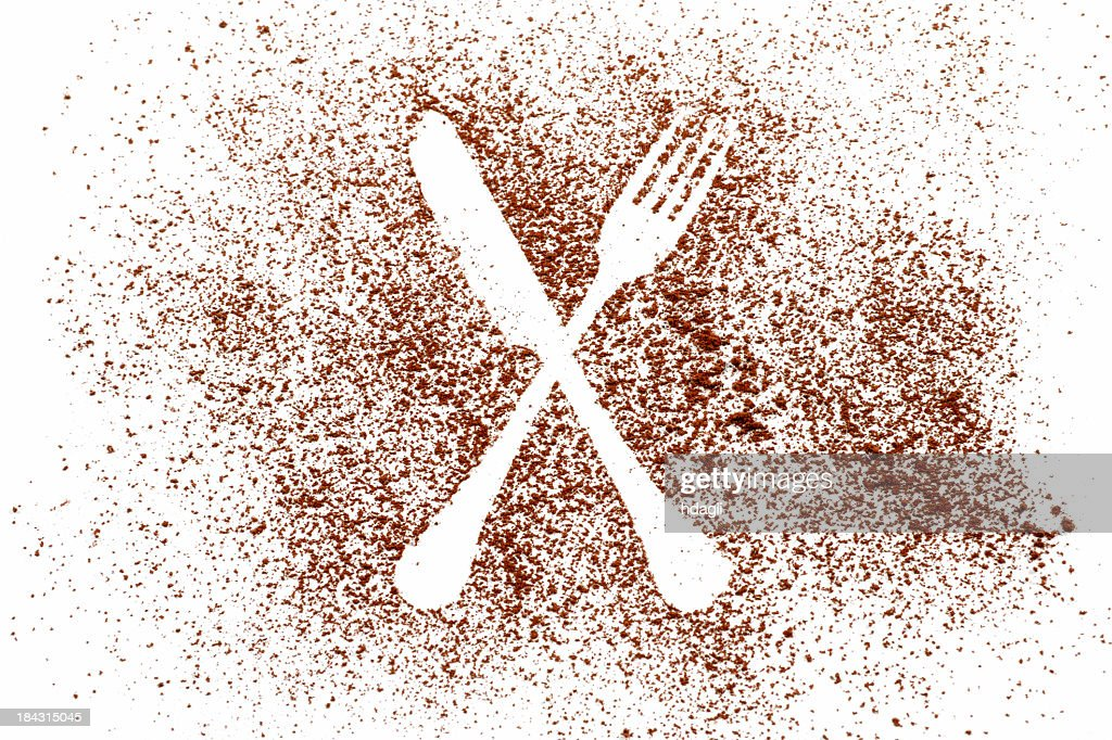 Image in cocoa powder of a knife and spoon outline, on white