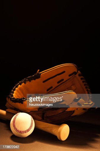 Image of a baseball glove with bat and ball