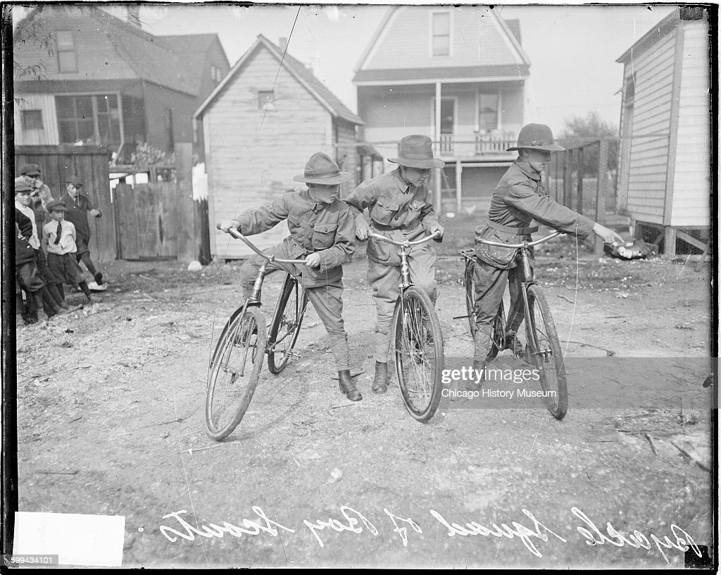 Image of a group of 3 Boy Scouts on bicycles during Field Day at Comiskey Park home of the Chicago White Sox in the Bridgeport community area Chicago...