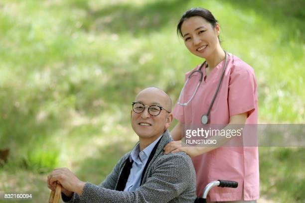 Image of a nurse nursing a sick person