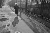 Image of a Senior Adult Woman Walking Down a Street in Paris, Rear View, Paris, France
