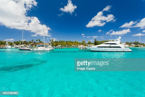 Image of a small yacht sitting on the dock. : Stock Photo