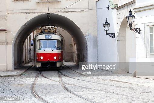 Image of a tram under a bridge in Prague