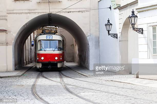 Image of a tram under a bridge in Prague