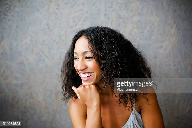 Image of a Woman Smiling in a Cafe