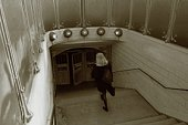 Image of a Woman Walking Into a Subway Entrance, High Angle View, Paris, France