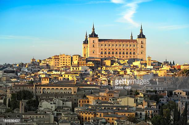 Image of Alcazar with half of town lit by the sun