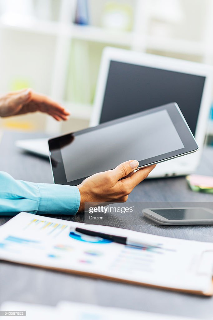 Image of business person in office reading financial news : Stock Photo