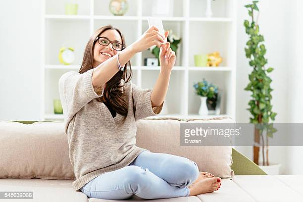Image of cheerful woman taking selfie shot and smiling