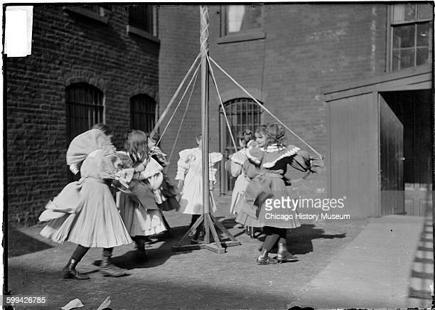 Image of deaf girls dancing around a maypole in a schoolyard Chicago Illinois May 8 1903 From the Chicago Daily News negatives collection