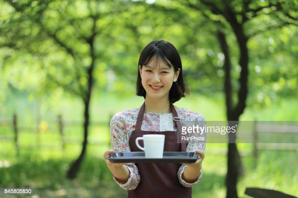 Image of female employee who is serving