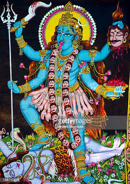 Image of Goddess Kali stepping on her consort Shiva's body as he protects the Earth from her wild dance.