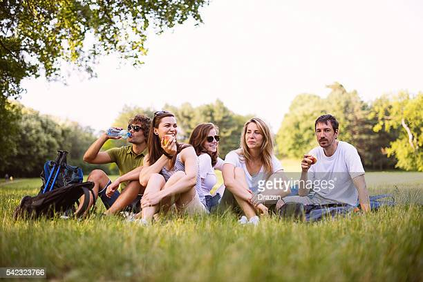 Image of group of friends in park after hiking