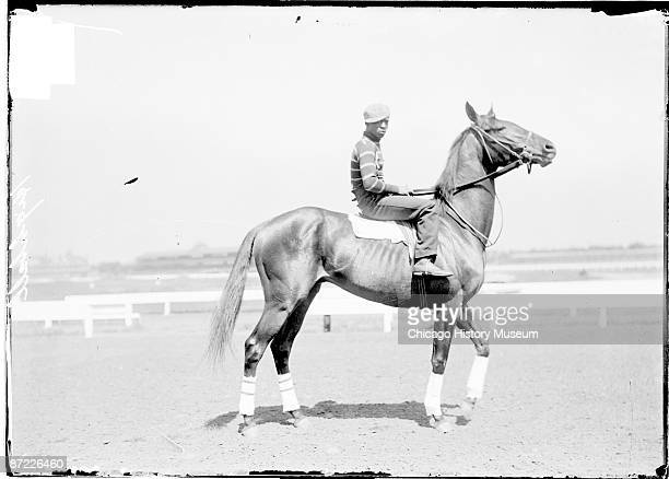 Image of Highball racehorse with African American jockey mounted standing on a racetrack in or near Chicago Illinois 1904 From the Chicago Daily News...