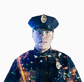 Image of mixed race police officer over cityscape