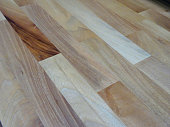 Photo showing some freshly laid oak effect laminate wooden flooring that is part of a hallway floor.