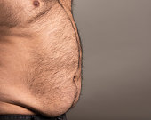 Studio image of overweight mans stomach and chest. With copy space, ready to add your text.