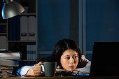 Image of sleepy doctor with coffee
