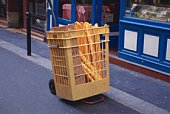 Image of Some French Bread in a Yellow-colored Basket, Side View, Paris, France