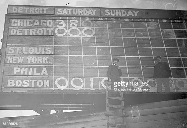 Image of South Side Park scoreboard during a game between Chicago White Sox and the Detroit Tigers Chicago 1905 Two boy score changers are standing...