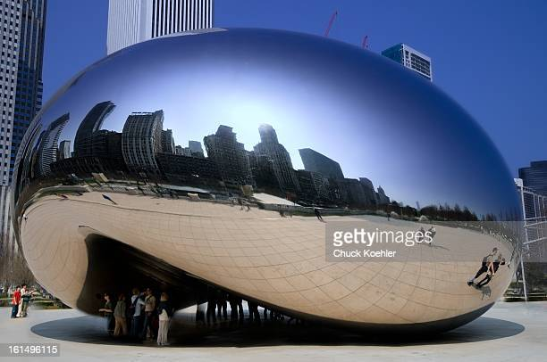 CONTENT] Image of the Cloud Gate Sculpture in Chicago's Millennium Park The city surrounds the Bean is also reflected from it on a bright sunny day