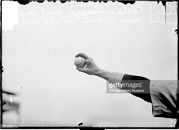 Image of the hand of Mordecai Brown Hall of Fame pitcher for the Chicago Cubs of the National League holding a baseball to demonstrate finger...