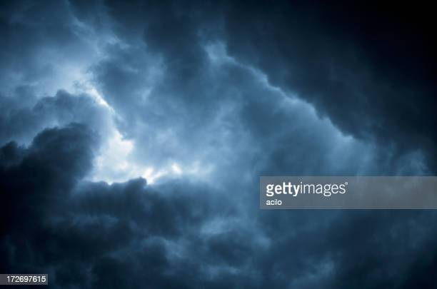 Image of the sky with dark blue and black storm clouds