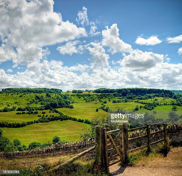 HDR image of wooden gateway with countryside backdrop, Cotswolds, Gloucestershire