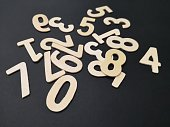 Image of the solid wooden numbers with black color background.