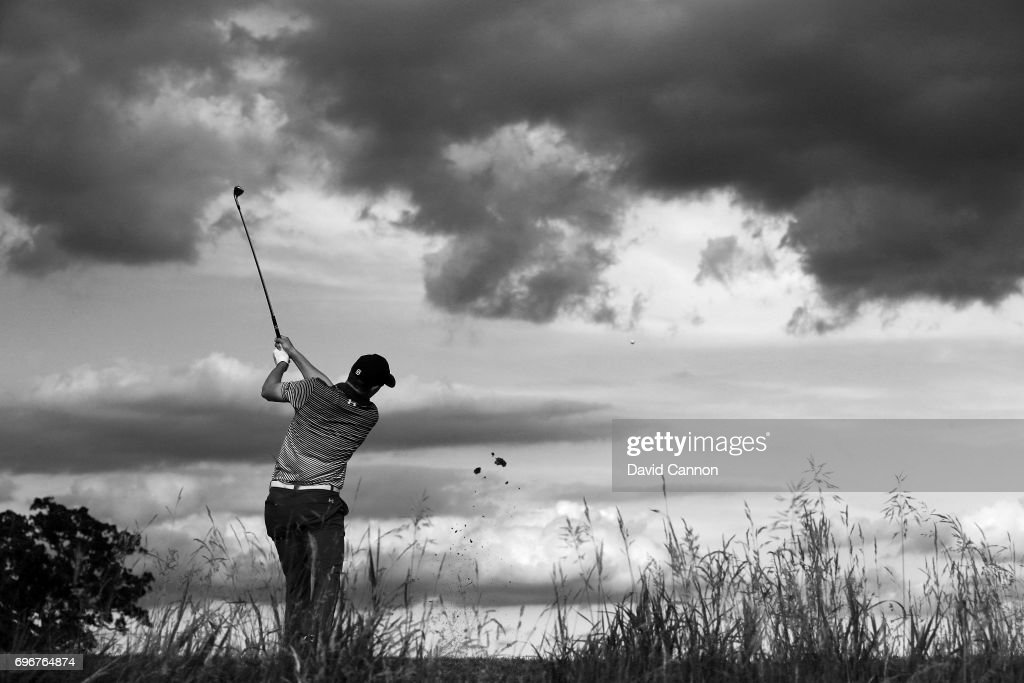 Image originally shot in colour; Jordan Spieth of the United States plays his tee shot on the par 3, 16th hole during the second round of the 117th US Open Championship at Erin Hills on June 16, 2017 in Hartford, Wisconsin.